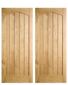 Solid Oak Centrally Boarded Arch Headed door. In stock at Venables Brothers Ltd.