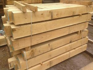 Fresh Sawn European Oak Beams in Venables Brothers Ltd Yard.