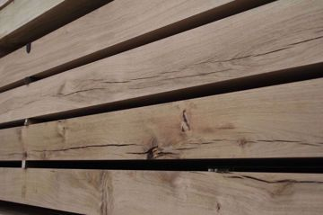 Planed All Round Oak Beam in Venables Brothers Yard